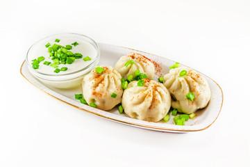 Georgian dumplings Khinkali with meat and green onion