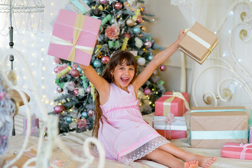 Adorable blonde girl with Christmas gifts