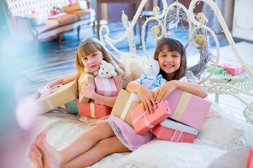 Two adorable girls with Christmas gifts