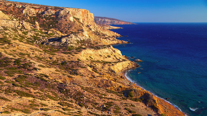 Scenic views of the sea from a height. Red Beach is located near the village of Matala, Crete. Forbidding coast of the Libyan Sea. Sandstone cliffs.