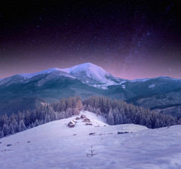 Photo sur Plexiglas A small village in the Carpathians snow, night starry sky