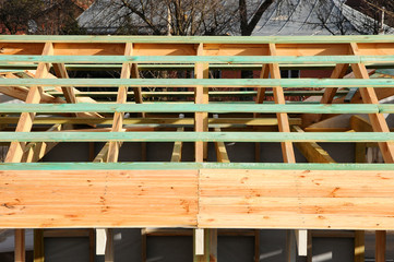 New unfinished roof construction. Wooden roof frame.