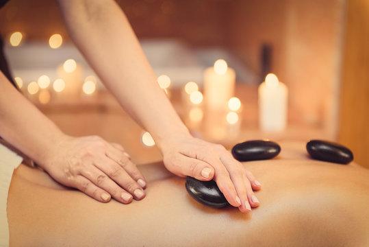 Masseuse massaging human body at spa