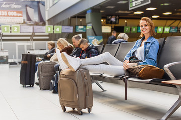 Carefree young woman relaxing in airport