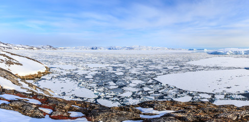 Ice fields and drifting Icebergs at the Ilulissat fjord, North G