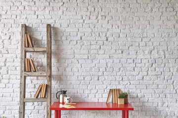 white brick wall and red table concept