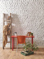 white brick wall chair and table decoration concept