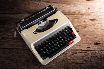 Vintage typewriter on wooden table