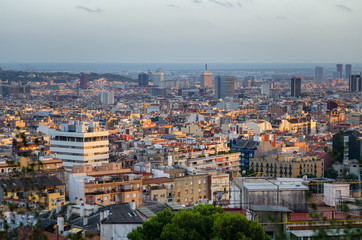 Barcelona cityscape and sea in sunset light, Spain
