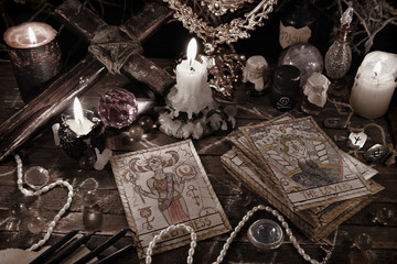 Mystic ritual with tarot cards, magic objects and candles in grunge style