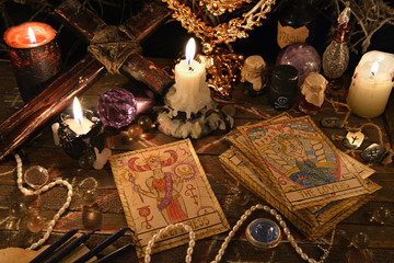 Mystic ritual with tarot cards, magic objects and candles