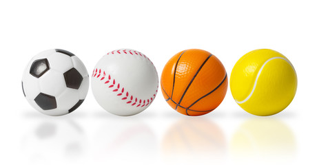 4 small sports balls isolated over white
