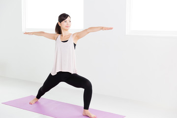 young asian woman exercising in sports gym