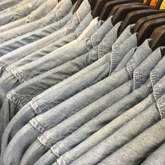 Denim Shirts hanging on a rack in the store.