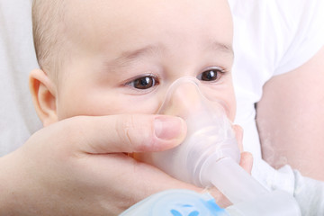 Baby boy at the hospital gets inhaler treatment for cough