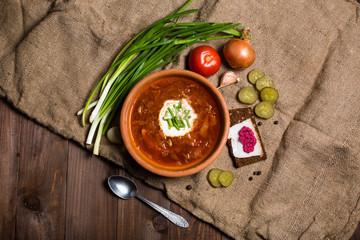 Ukrainian Lunch: soup, pickled cucumbers, garlic