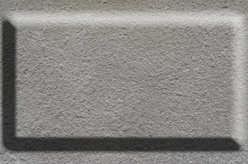 Texture of rough concrete surface with bulky gray highlighted portions which can be seen on exposure to light. Preparation for the background processing of slides, spreadsheets, or infographic