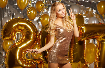 Woman and Happy 2017 gold New Year Balloons