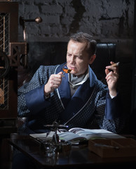 Man with a pistol at a desk writing a letter