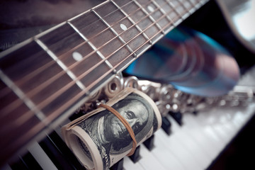 Music instruments.Music and money concept.