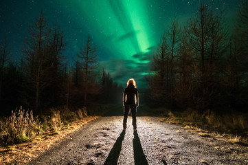Northen lights with silhouette of person (Aurora Borealis) in Iceland