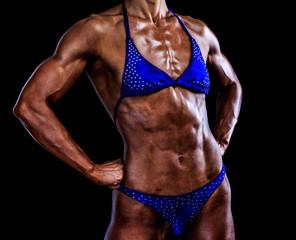 Woman bodybuilder on black background