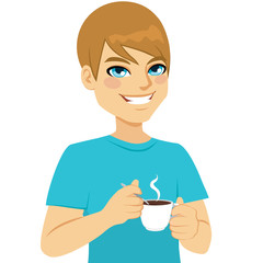 Man relaxing taking a cup of hot coffee