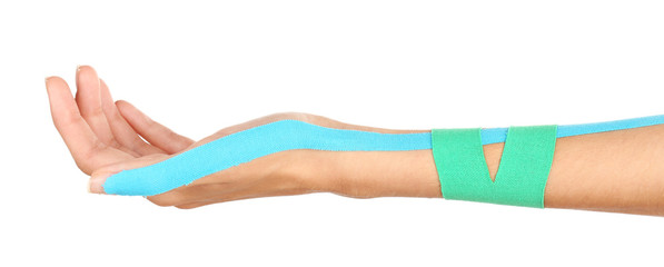 Physiotherapy concept. Female hand with physio tape on white background