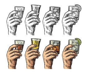 Male hand holding a glasses with tequila, rum, whiskey and ice cubes.