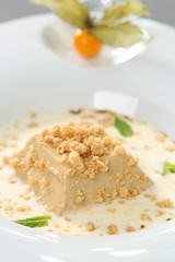 Fine dining - creme caramel with sauce dessert