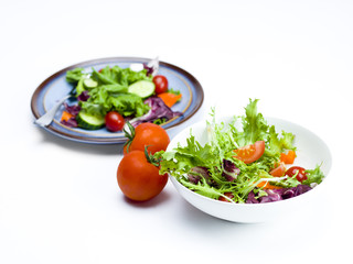 plate and bowl of salad