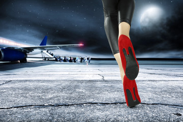 woman legs and airport