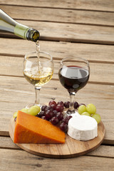 view of cheese with grapes and wine