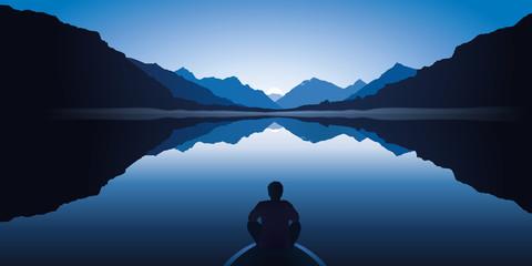 Un homme zen, assis à l'avant d'une barque, médite en contemplant le paysage calme et magnifique d'un lac entouré de montagnes.