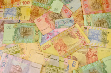 Background image of many Ukrainian banknotes of different colors and size. Conceptual image for the Ukrainian banking operations, withdraw funds, wealth and possession of huge sums of money in Ukraine