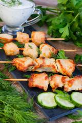 Skewers of chicken on wooden skewers