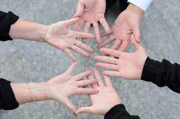 Overhead view of three friends and their hands
