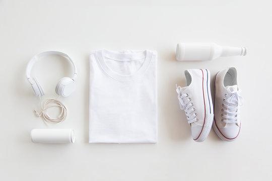 Blank stuff on white background. Template for design presentations. Branding Mock-Up. Shirt, sneakers, headphones, bottle.