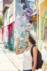 Girl hydrates in a summer day