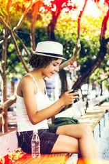 Young woman looking at digital camera