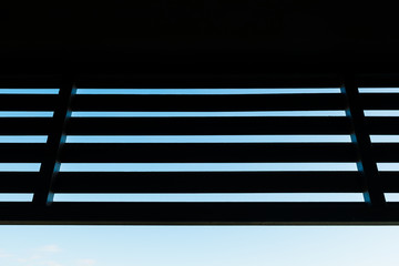 silhouette wooden slat with blue sky