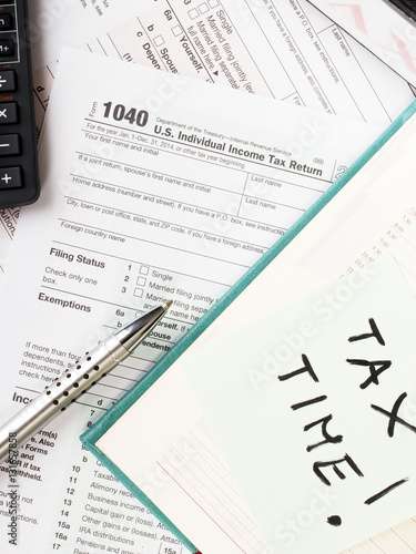 Close up u s individual tax form 1040 with calculator for 1040 line 28 tax table