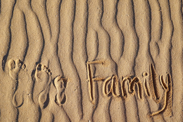 """The word """"family"""" and foot prints on the sand dunes Fuertoventury, Canary Islands"""