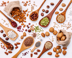 Wall Murals Spices Various legumes and different kinds of nuts in spoons. Walnuts k