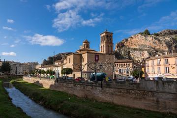 Church of Natividad de la Virgen in Alhama de Aragon, Zaragoza (Spain), and the river Jalon.