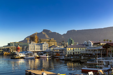 Photo on textile frame South Africa Republic of South Africa. Cape Town (Kaapstad). Waterfront - Victoria Basin with historical buildings. Devil's Peak and Table Mountain in the background