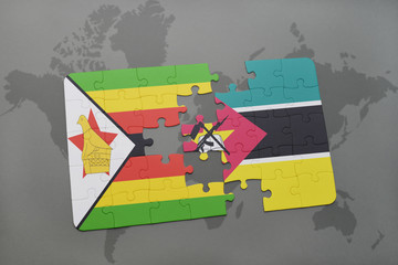 puzzle with the national flag of zimbabwe and mozambique on a world map