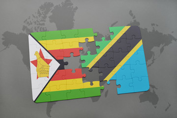 puzzle with the national flag of zimbabwe and tanzania on a world map