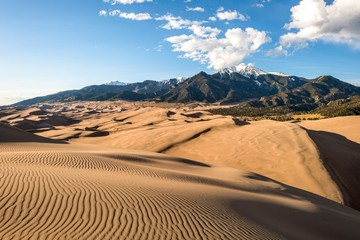 Sunset view of sand waves at the top of Great Sand Dunes, Great Sand Dunes National Park & Preserve, Colorado, USA. Wall mural