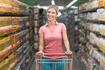 Woman Driving Shopping Cart While Grocery in Supermarket